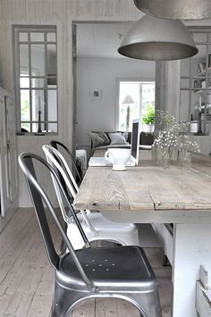 love the metal chairs with rustic wood dining room table