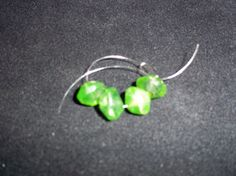 Vintage uranium vaseline glass beads. UV by JewelryStatements, $15.00