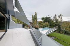 Image 29 of 35 from gallery of CoMED / architekten ZT KG. Photograph by Hertha Hurnaus Photography Architecture Design, Amazing Architecture, Glass Pool, Glass Railing, Outdoor Living Areas, Modern House Design, Modern Houses, Stairways, Facade