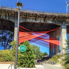 There is potential everywhere-- as proven by this long unchanged bridge which got a makeover by Viva Vancouver. Bright orange fabric strung underneath the Burrard Bridge is an exciting change, especially for the cyclists riding along the bike path that passes below. #LQC #Placemaking