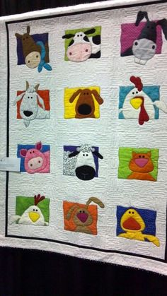 Animal applique quilt -  Animal Whimsy Quilt Pattern by Amy Bradley Designs....(such a cute, whimsical quilt! must have been fun to put it all together.love it!)....:
