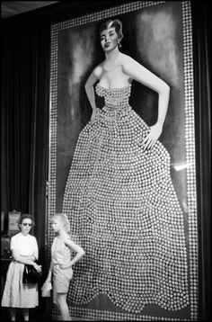 The Silver Queen: 15' Tall & 8' Wide. Her Gown has 3,261 Morgan Silver Dollars. Her belt has 28 Twenty dollar gold pieces, her jewelery is silver dimes. Virginia City, Nevada 1960