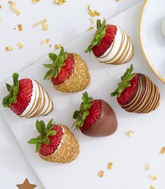 Champagne dipped strawberries perfect for New Year's Eve with gold sprinkles on a white table with glitter