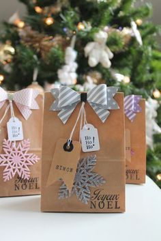 Cute Christmas wrapping ideas with brown paper bags and bows.