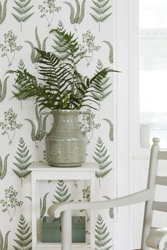 A beautiful and fresh pattern design featuring fern leaves and various other plants.