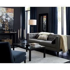 Moody blues, blacks and greys in this sitting room.
