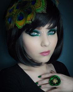 """Finally feeling better and here's a new shot! All the greens! Beautiful ring is by @thecagedbluebird it's so elegant and pretty!!!!! Fascinator is by @robyns_nest_fascinators and wig is """"Betty"""" by @lush_wigs check them out and leave them some love!  I love this makeup look I think it's a new favourite!  #mothqueenmakeup #mua #makeup #makeuplooks #lushwigs #lushwigsbetty #model #altmodel #altgirl by mothqueenmakeup"""