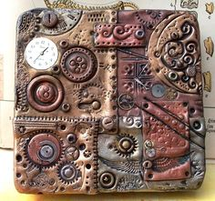 "Polymer clay steampunk tin by ValerianaSolaris on DeviantArt. She says ""I took a simple aluminium tin (size: 11 x 11 x 2 cm) and covered it with Fimo/polymer clay. The clay was stamped, textured, dusted with Pearl Ex pigments and embellished with clock parts. After baking, the whole thing received an antique patina."" Further down in the comments section she goes into even more detail about her technique. Excellent."