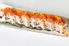 Heaven Roll($11.95) - Shrimp tempura, unagi topped w/ spicy tuna, tobiko, eel sauce