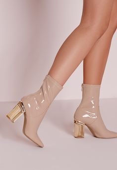 Ensure all eyes are on you with this seasons hottest heeled ankle boots! Featuring a clear gold block heel, zip to the back and shiny patent finish in a dreamy nude, these boots are one fierce pair. Team up with your favourite mini skirt fo...