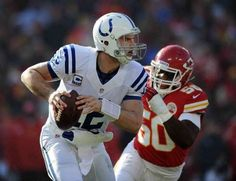 Indianapolis Colts QB Andrew Luck scrambles away from Kansas City Chiefs LB Justin Houston,right, in the first half of their game Sunday afternoon at Arrowhead Stadium in Kansas City MO. Matt Kryger / The Star