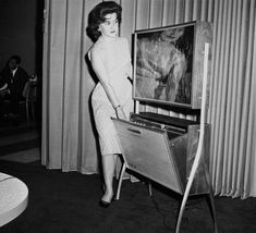 A thin flat TV screen (only 4 inches thick) with automatic timed recording for TV shows is the wave of the future shown at the Home Furnishings Market in Chicago Illinois on June 21 1961 Tvs, Radios, Radio Record Player, Radio Antigua, Flat Tv, Rare Historical Photos, Old Technology, Vintage Tv, Entertainment