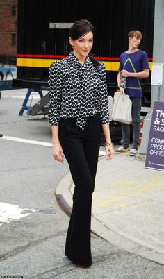Printed black and white blouse with black slacks. | Office Style