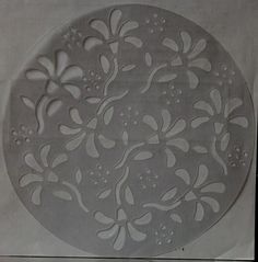 Clear Flowers Round Stencil is available at Scrapbookfare.