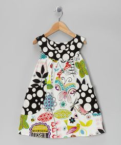 LOVE this fun print! White Crazy Flower Pocket Yoke Dress by SILLY MILLY