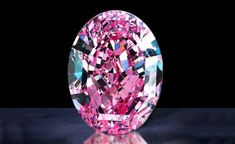 "The Steinmetz Pink    A 59.60 carat diamond rated as Fancy Vivid Pink by the GIA, it is the largest ever with this rating. It is said to be displayed at the Smithsonian, ""The Splendor of Diamonds"""