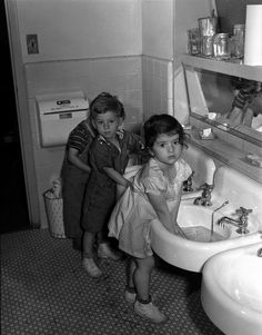 Children wash before lunch at the nursery school at the Red Hook housing project community center in Brooklyn, New York. Photograph by Arthur Rothstein, June 1942. | vintage 1940s children clothes | 40s girl dress + boys in overalls