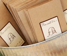 "thank your guests for coming with a bag of treats from your candy bar. To add a country touch these plain brown bags and a sticker with the phrase ""How sweet it is..."" plus a monogram"