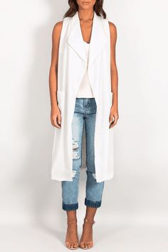 TUESDAY AFTERNOON LONGLINE VEST ow good is the Tuesday Afternoon Longline Vest! Featuring a longline, sleeveless fit, with a lapel style neckline. Lightweight fabrication. Easy fitting. Complete your outfit with the Be My Always Mom Jeans and the Everybody Knows Cami Top.
