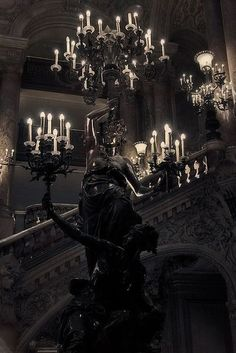 Another great example and something to consider when deciding on the mood / atmosphere looking to create in the space - this is dark and brooding with accent lighting provided by ornate chandeliers - gorgeous and makes one think!!!