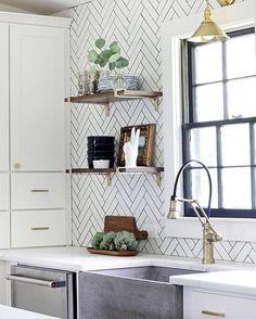 White kitchen with herringbone backsplash