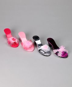 This set features plenty of perfectly matching shoes for darling dress-up endeavors. Any princess can be queen for a day while prancing around in a pair.Includes four pairs of shoes7'' long2'' heel100% plasticImported