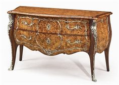 Luxury furniture. Burl serpentine bomb chest.