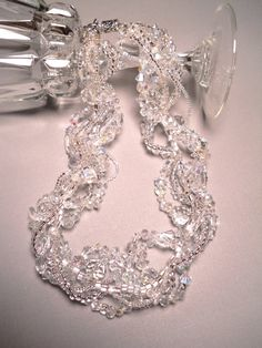 Custom order - Crystal necklace made with many Swarovski Austrian crystals, Fire polished and other glass crystals, sparkling cut glass, clear Quartz and clear Opal stones. There are eight strands of pure, glimmering, icy fire - a necklace for a princess. I can make one for you, too!