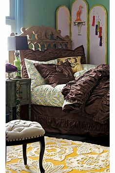 one day when i need the mix of masculine and feminine this will be my future bedroom. I love the yellow rug :)