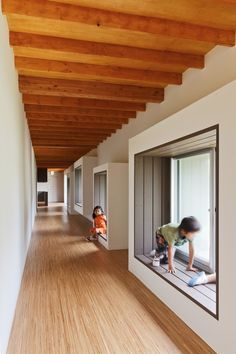 ***Different height cubbies to climb in--one at the window (window seat, but a framed-in cubby), and then two others, maybe one on each of the other walls. Minimal, low bookshelves in-between or underneath