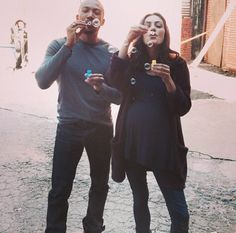Charles Michael Davis and Phoebe Tonkin blowing bubbles