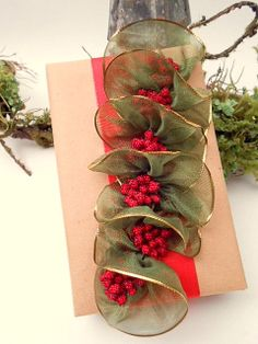 gift wrap - a bit to do - craft paper, flat red ribbon, an organza spiral with berries  -  http://la-couronne.de/