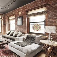 Brick walls, modern bohemian vibe. Love this eclectic combination!