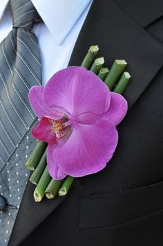 A vibrant and tropical boutonniere. For more wedding planning tips, check out our website - http://bridalmentor.com/.