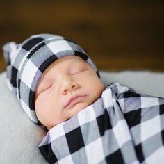 This lightweight swaddle is the cutest way to wrap your newborn baby. Its soft and stretchy and perfect to keep your baby comfortable and cool while sleeping. It also is a great blanket to lay your baby on, a great cover while nursing, and a comfort blanket for your toddler to snuggle with as they grow. The swaddle is a perfect baby shower gift as well. Swaddle is made with a rayon/spandex blend and is cut and serged around the edges. It measures approx 40 x 40 inches. The hats are made ...