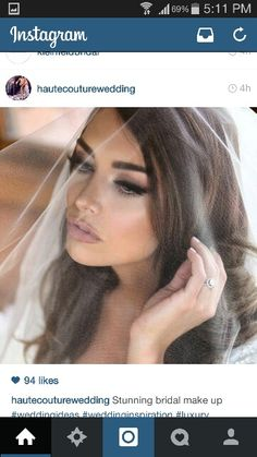 Love her make up and veil