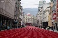 Sarajevo - 11541 empty red chairs - one for every man, woman and child lost during the longest siege in modern history 1992 - 1995.  Created by Haris Pasovic.