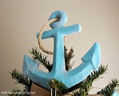 DIY Nautical Christmas Tree Topper Idea Made with Paper Mache Anchor. Statement Tree Toppers with a Coastal Nautical Theme, Featured on Completely Coastal.