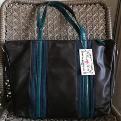 FINAL REDUCTION 🎉Black with Teal Bag SALE This classic purse has great multi teal toned accent stripes to add dimension!  Soft and leather like material. Great chunky metal zipper on top, inner pockets and a shoulder strap in case you want to change it up. Don't miss out on getting this and you can take advantage of my bundle discount! Bags Shoulder Bags