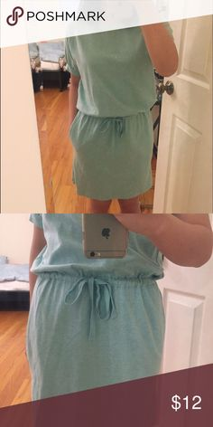 Uniqlo sweater dress Mint green. Sweater material. Really comfortable. Has pockets. Adjustable straps at the waist. Worn only once! Uniqlo Dresses Midi