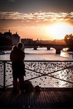 Pont des Arts - Paris. Couples attach locks with their initials onto the bridge railings to symbolize their unending love.
