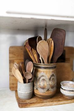 More from Anne Parker's kitchen. Her earthy collection of pottery & wood is prolific & perfect.