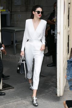 In Paris wearing a white blouse and trousers. - HarpersBAZAAR.com