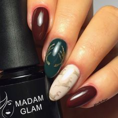 Christmas or winter holiday design. Hand drawn antlers in gold with reindeer stamping. The dark green is Heart Attack and the burgundy is Dark Side, both from Madam Glam.