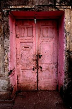 Old pink doors ~ if they weren't patinaed by age, I'd say it was brutal vandalism- ha! Since someone already ruined a beautiful old doorway anyway, I (at least) like it in this shade of pink. Les Doors, Windows And Doors, Front Doors, Cool Doors, Unique Doors, Portal, Pink Lila, Pink Tutu, When One Door Closes