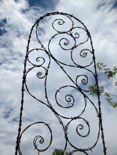 Spirals Galore Barbed Wire Spirilian Trellis. $59.00, via Etsy.