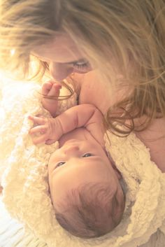 Such a beautiful picture capturing a sweet moment with mommy and baby.