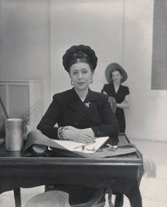 The one and only, Lilly Dache.  French-born, New York based milliner who made hats for starlets to stenographers in the 1950's.