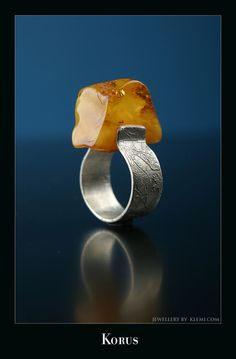 Klemi: silver and amber<- oh.....I thought it was a tiny taco in a tiny taco holder...
