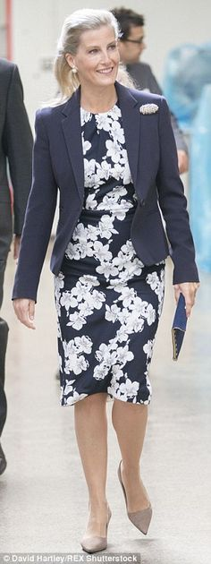 The Countess teams a chic blazer with a floral-print dress on a visit to Wiltshire